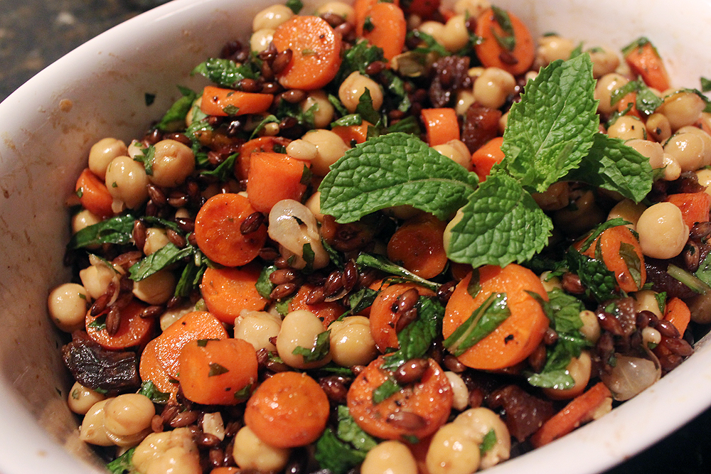 In a large bowl, combine the carrots, chickpeas, pine nuts ...